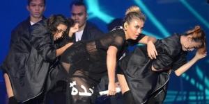 Arti Tulisan Arab di Baju Agnes Monica 2
