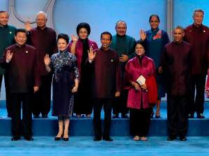 Asia Pacific Economic Cooperation (APEC) nations' leaders and spouses pose for a family photo at Beijing National Aquatics Center, or the Water Cube, in Beijing, November 10, 2014.